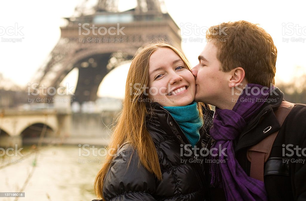 Happy loving couple by the Eiffel Tower in Paris royalty-free stock photo