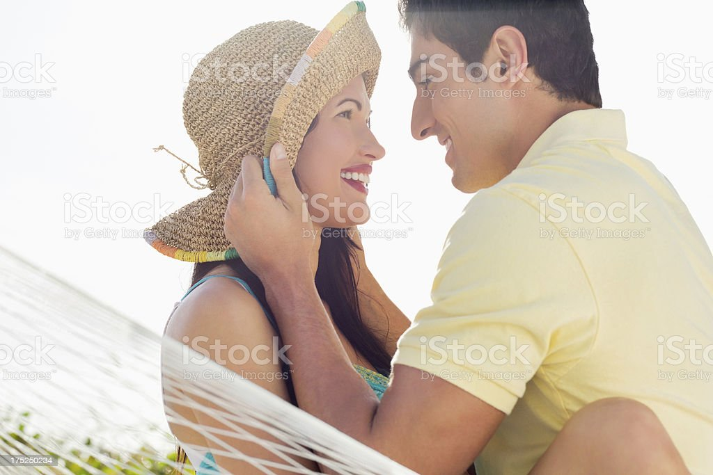 Happy Loving Couple Looking At Each Other In Hammock. royalty-free stock photo