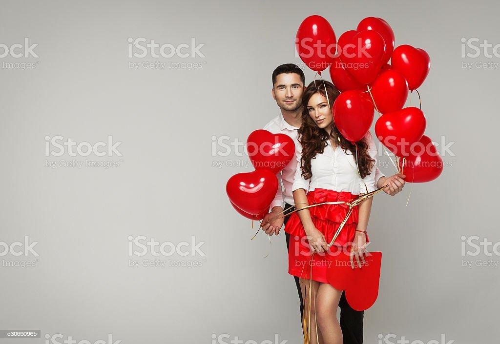 Happy loving couple on grey background stock photo