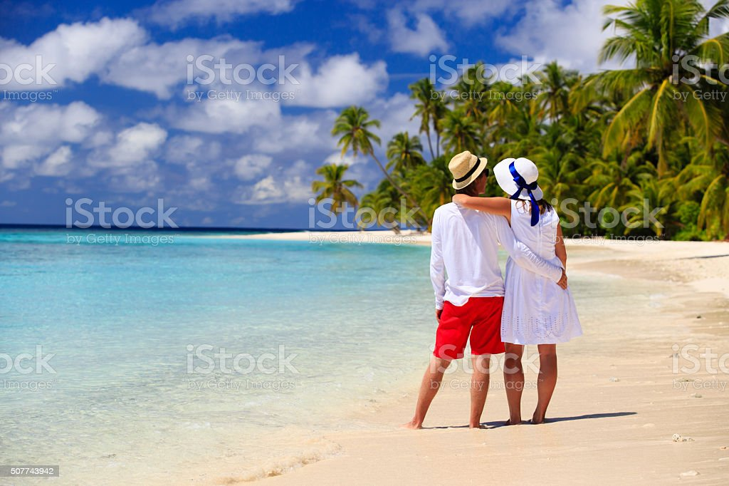 happy loving couple on summer beach stock photo