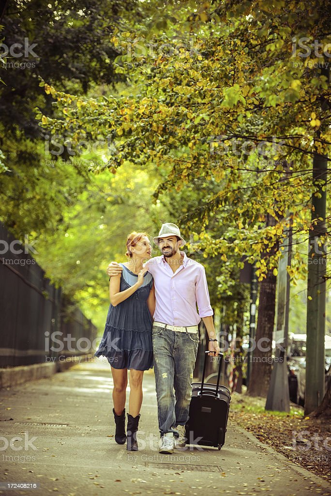 Happy Loving Couple  walking with suitcase, ready for traveling stock photo