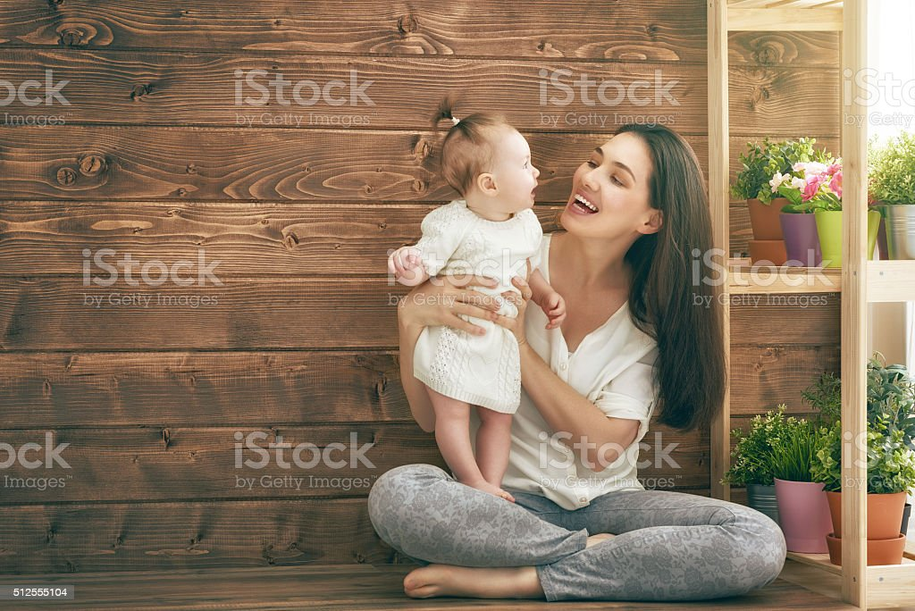Happy loving family. Mother and her child baby girl playing in the...