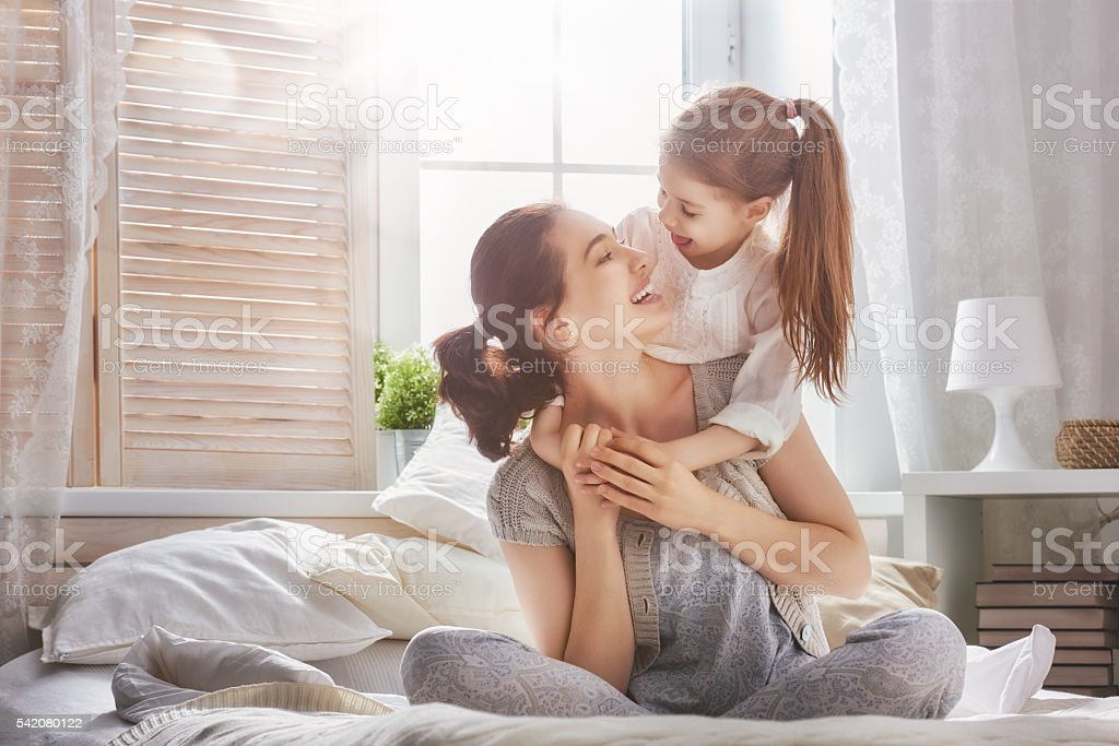 Happy loving family. Mother and her daughter child girl playing and...