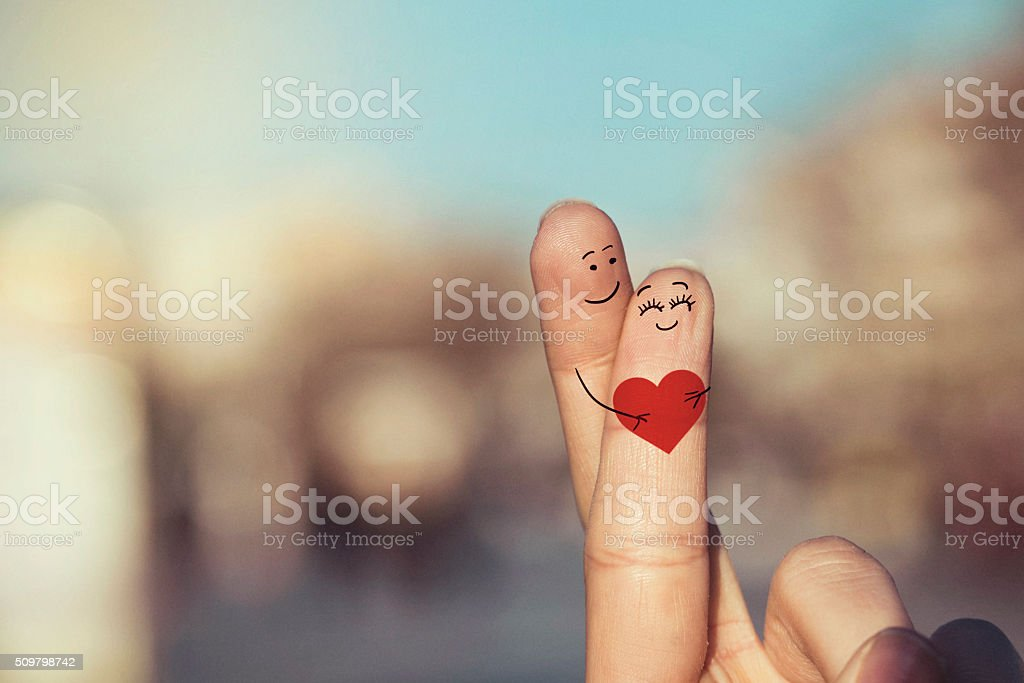 Happy loving fingers holding red heart stock photo