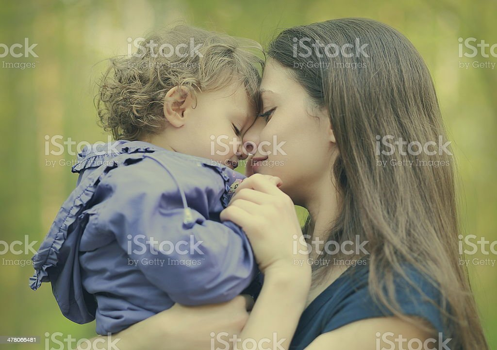 Happy loving mother and baby girl embracing outdoor royalty-free stock photo
