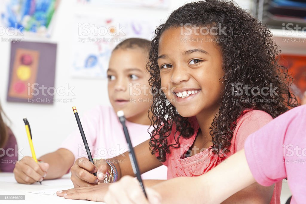 Happy lttle girl looking up during art class royalty-free stock photo