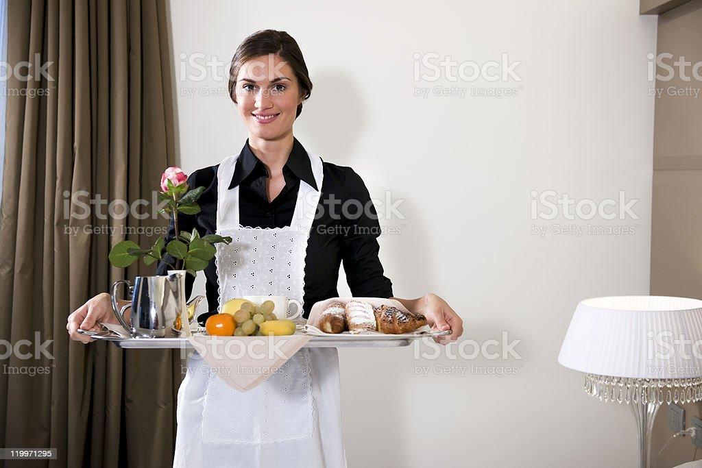 Happy Maid Carrying Breakfast Tray royalty-free stock photo