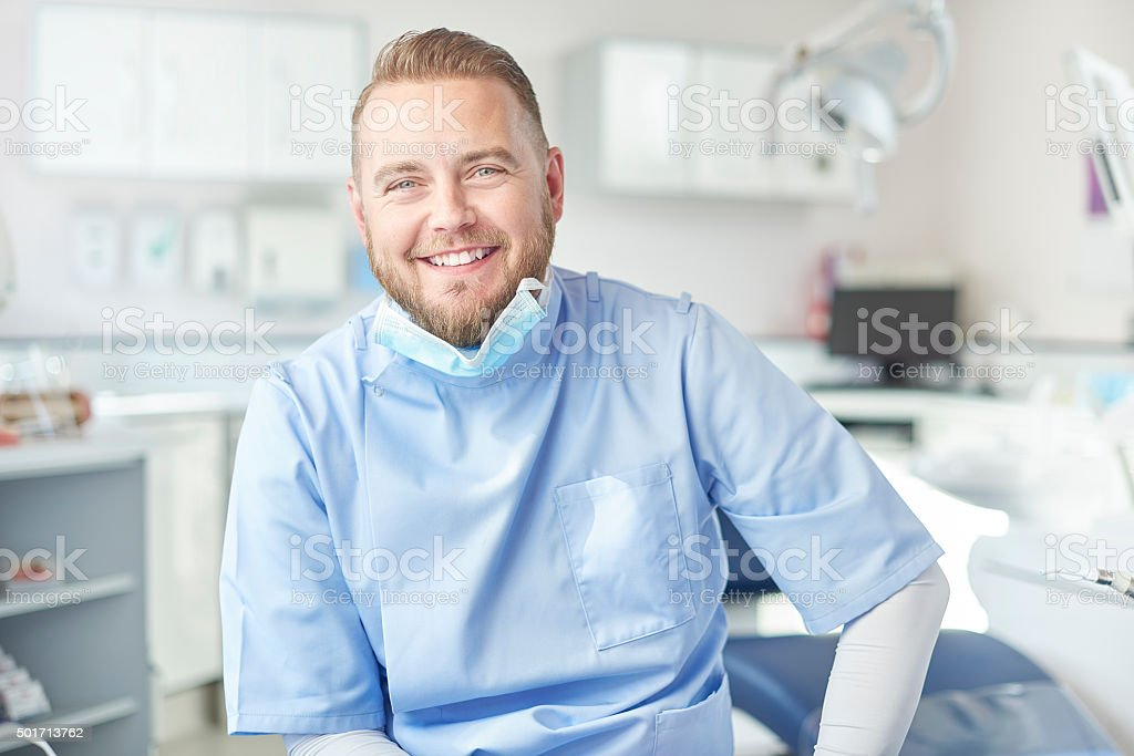 happy  male dentist portrait stock photo