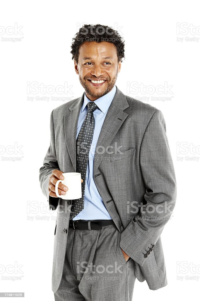 Happy male executive with a cup of coffee looking away royalty-free stock photo