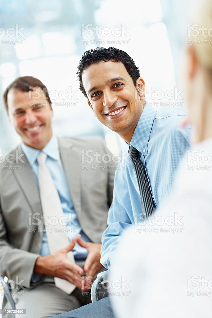 Happy male executive with colleagues in office royalty-free stock photo
