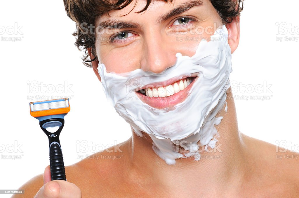 Happy male face with razor over white stock photo