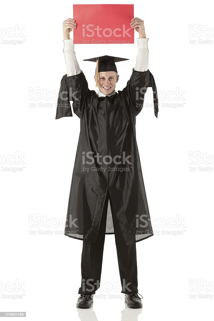 Happy male graduate holding a placard royalty-free stock photo