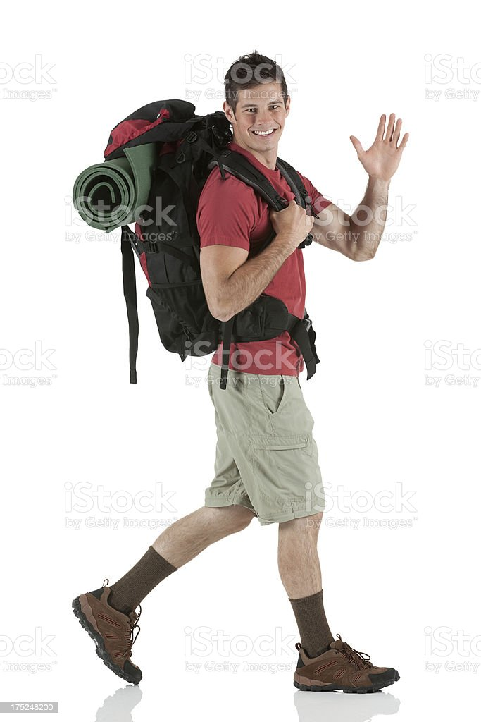 Happy male hiker waving his hand royalty-free stock photo