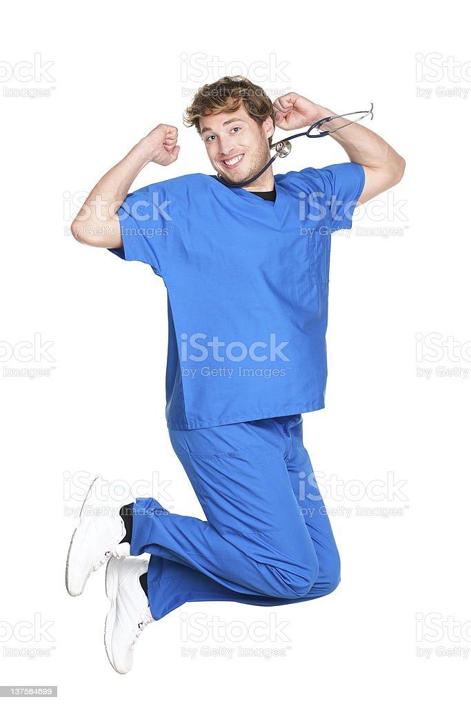 happy male nurse / doctor jumping stock photo