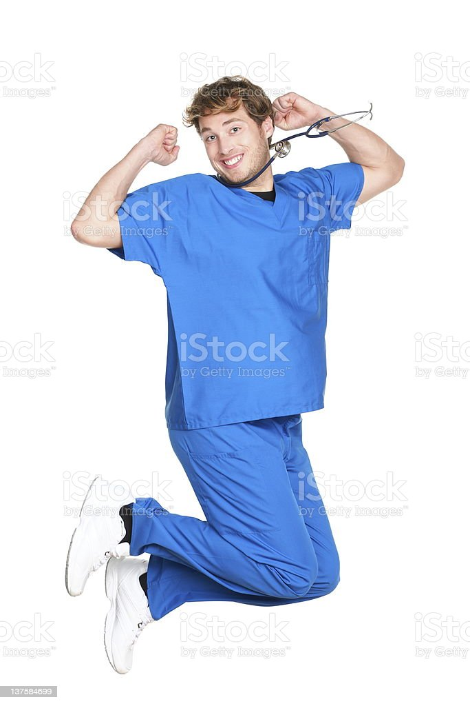 happy male nurse / doctor jumping stock photo