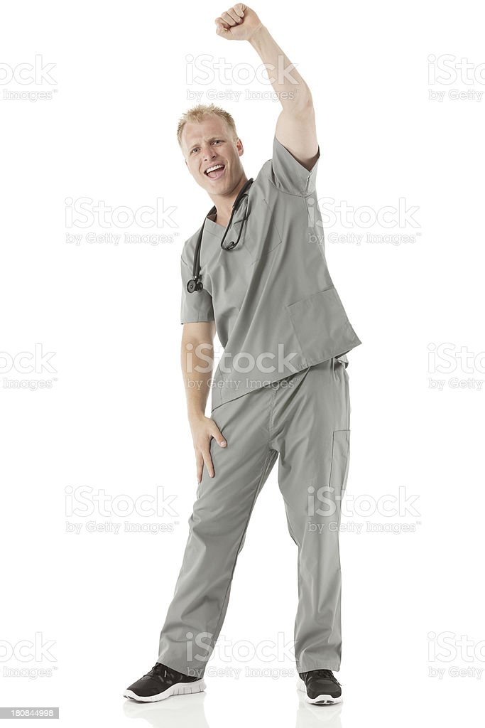 Happy male nurse with arms raised royalty-free stock photo