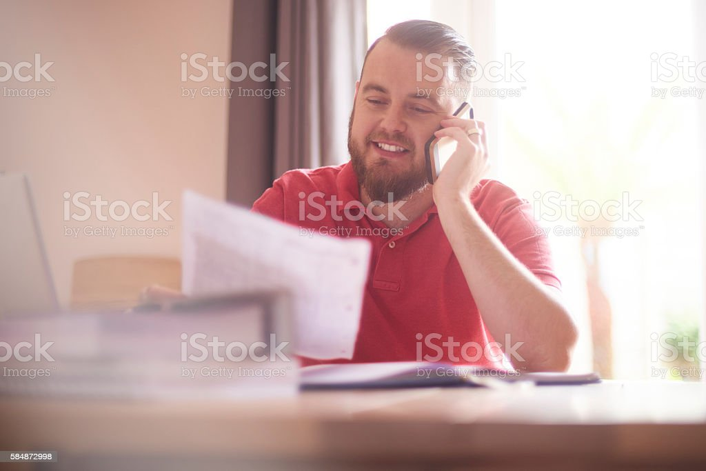 happy male on the phone with her mortgage company stock photo
