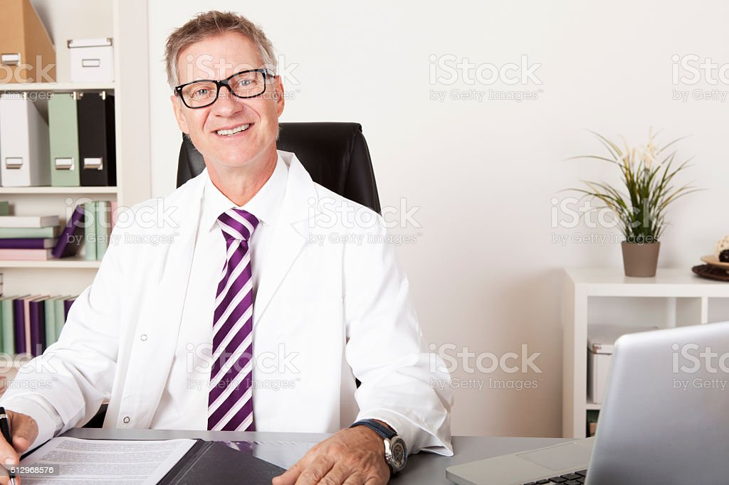 Happy Male Physician Looking at Camera stock photo