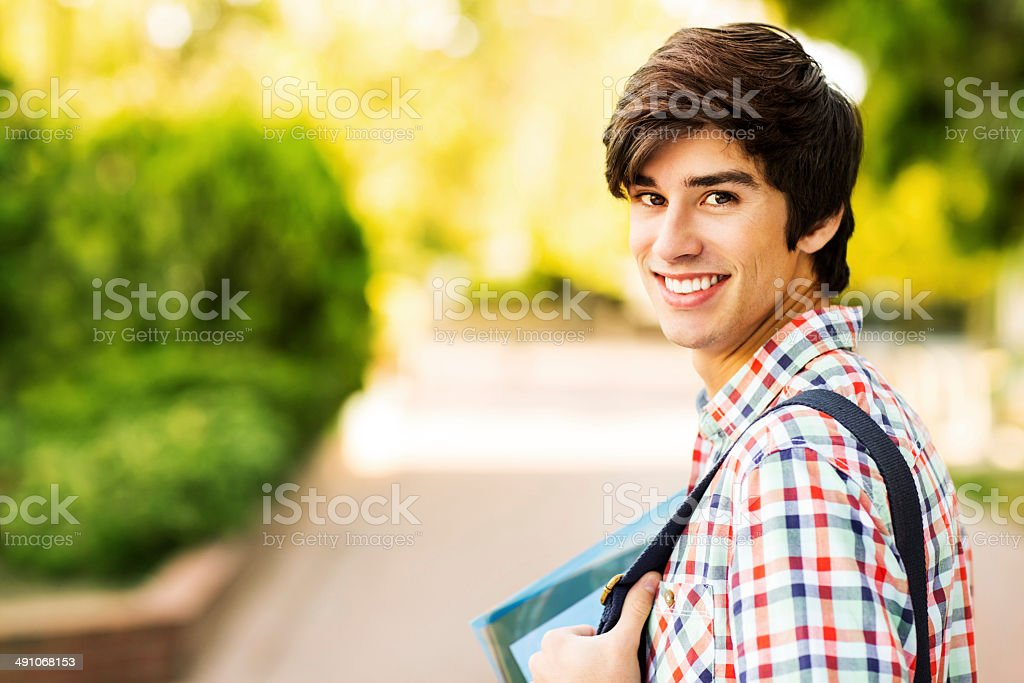 Happy Male Student On College Campus stock photo