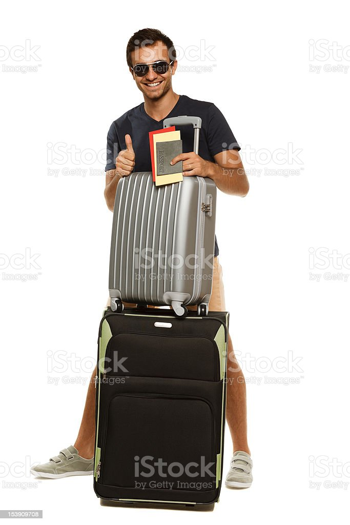 Happy male with suitcases showing thumb up sign royalty-free stock photo