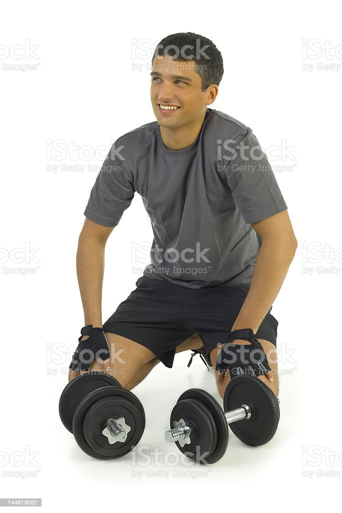 Happy man and dumbbell royalty-free stock photo