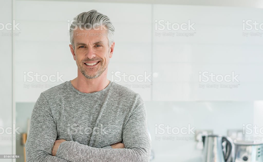 Happy man at home stock photo
