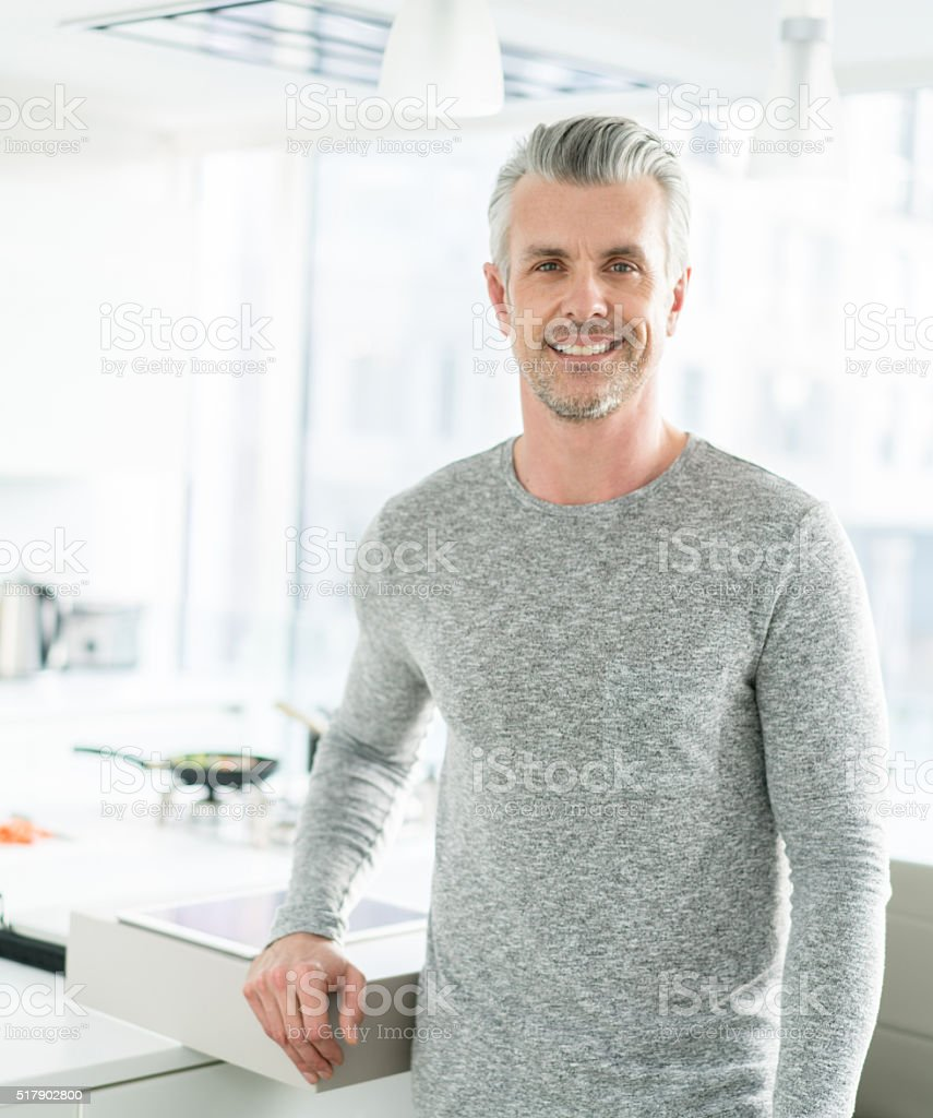 Happy man at home stock photo
