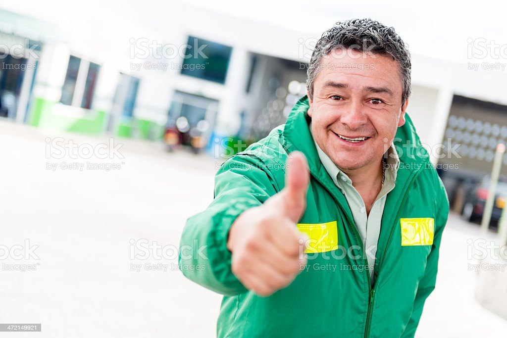 Happy man at the gas station royalty-free stock photo
