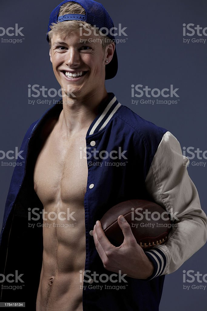 Happy man carrying an American football stock photo