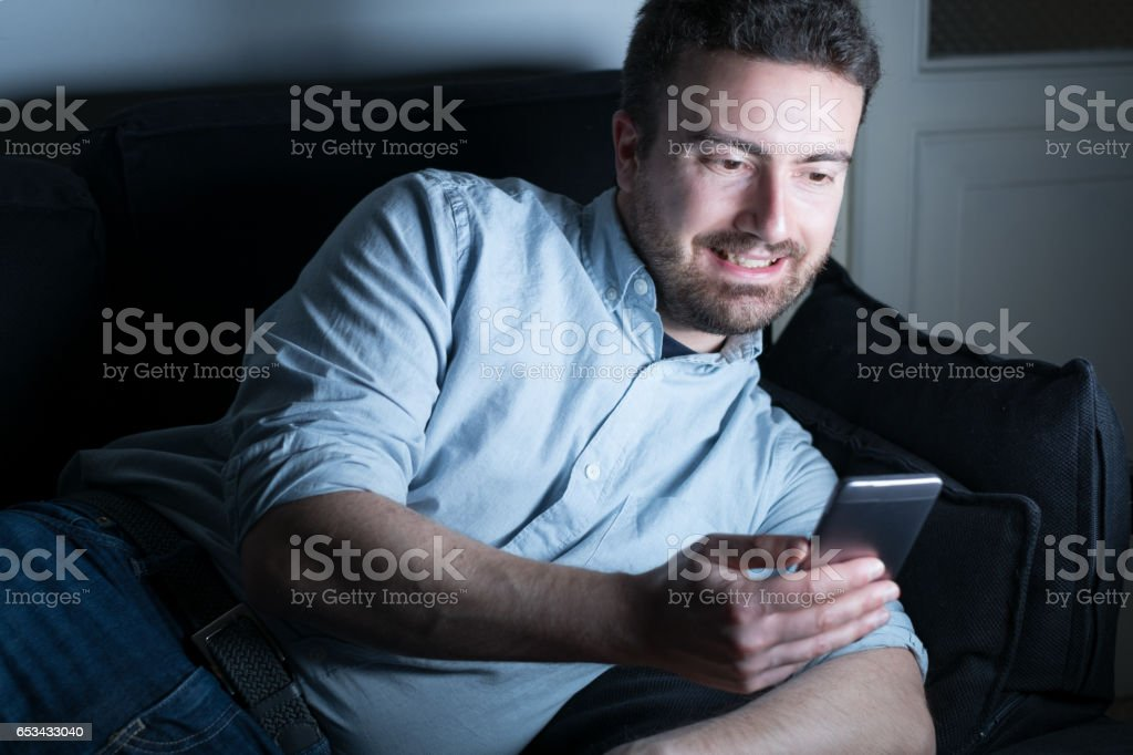 Happy man chatting on his mobile phone stock photo