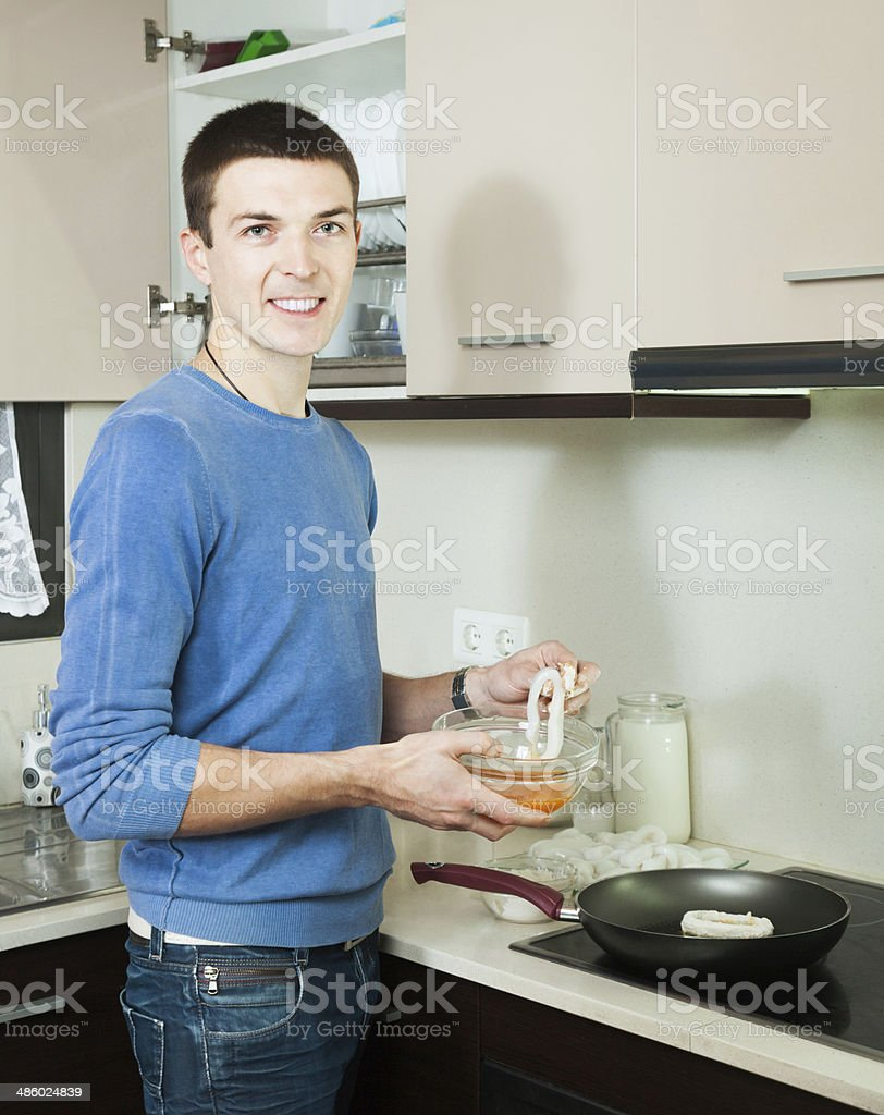 Happy man cooking frying squid royalty-free stock photo