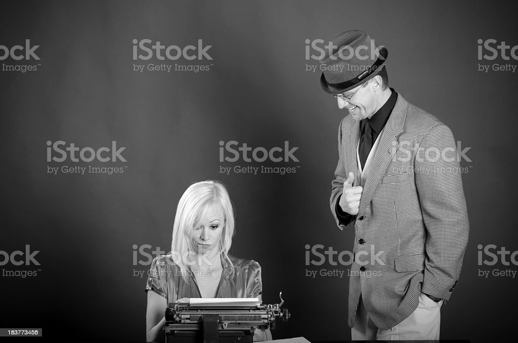 Happy man dictates to a confused beautiful secretary stock photo