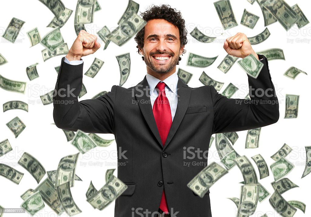 Happy man enjoying the rain of money stock photo