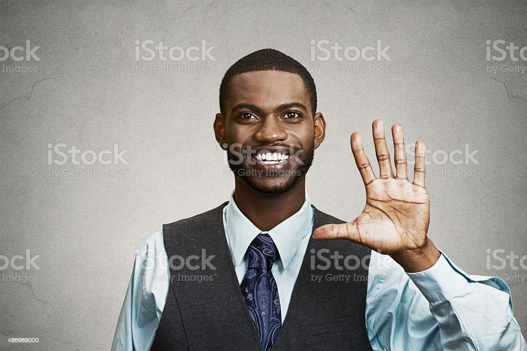 Happy man giving five times gesture with hand stock photo