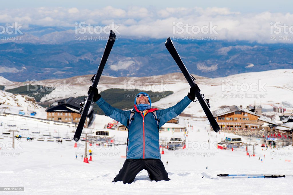 happy man happy in snow mountains at ski resort stock photo