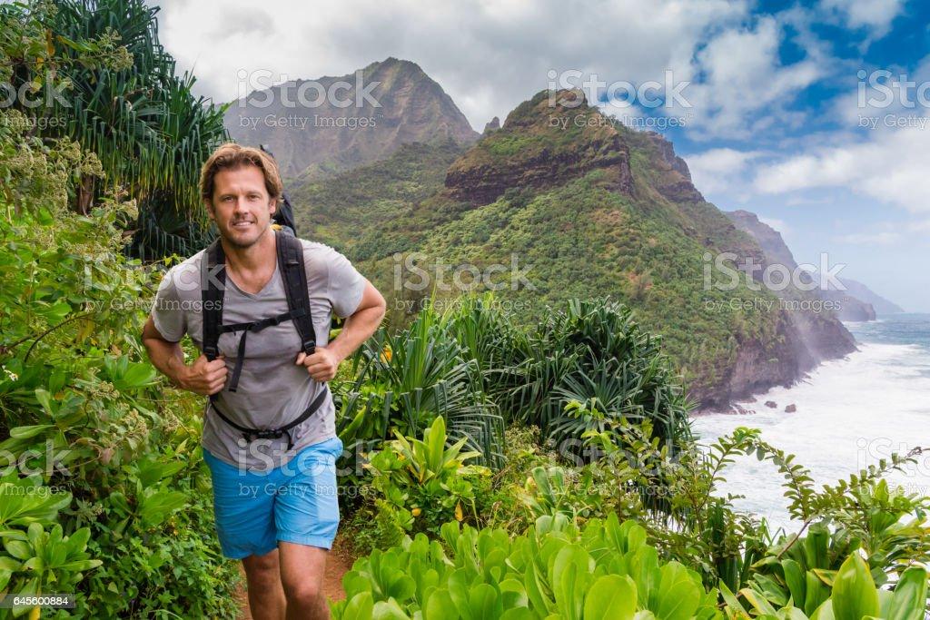 Happy Man Hiking Through The Jungle stock photo