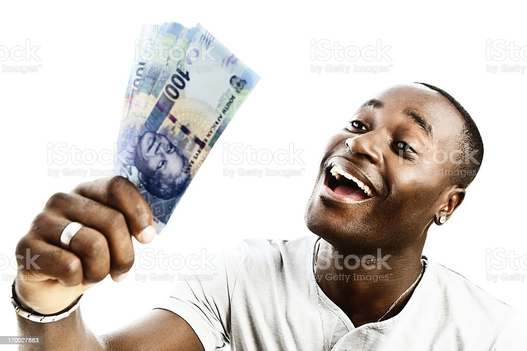 Happy man holding bundle of South African R100 banknotes stock photo