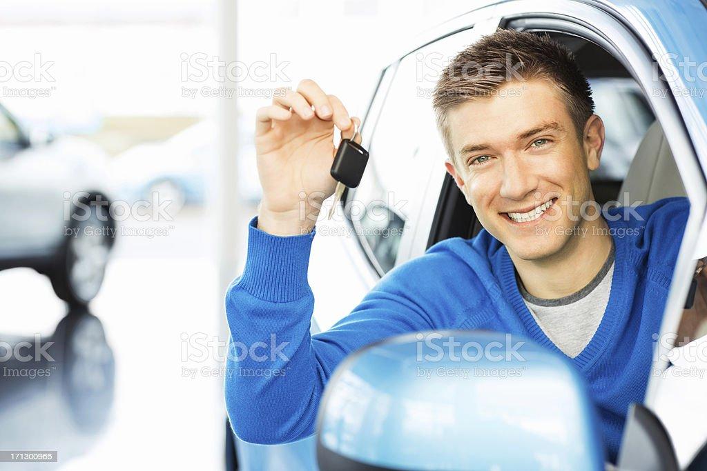 Happy Man Holding Car Key stock photo