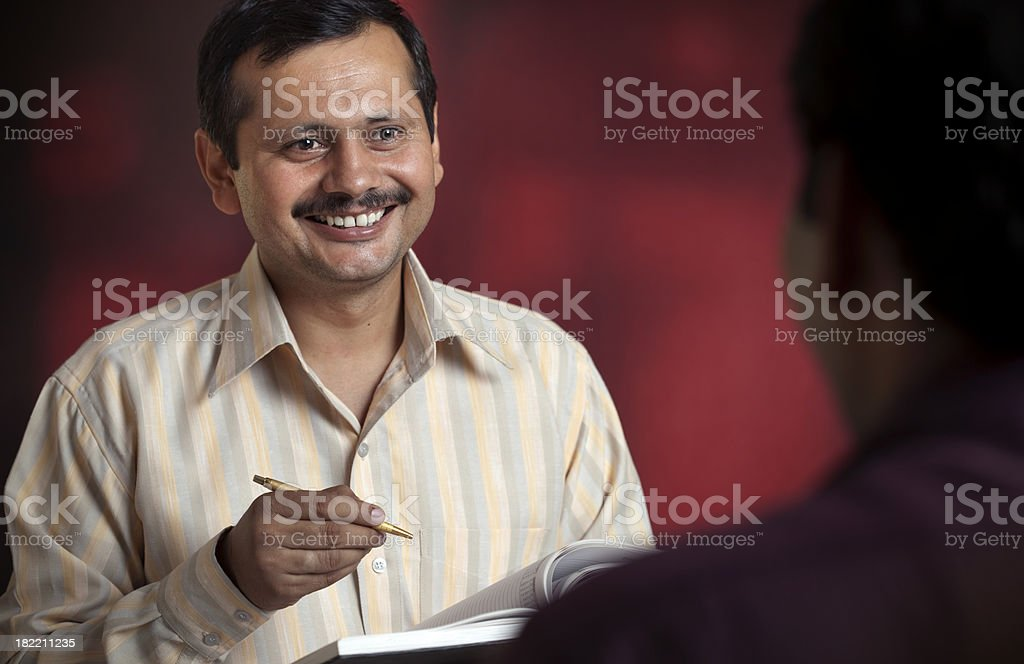 Happy man holding pen planner and talking to someone royalty-free stock photo