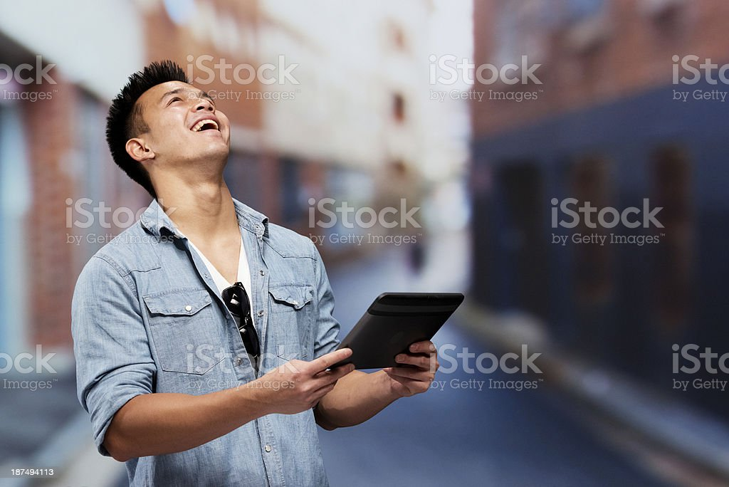 Happy man holding tablet in outdoors royalty-free stock photo