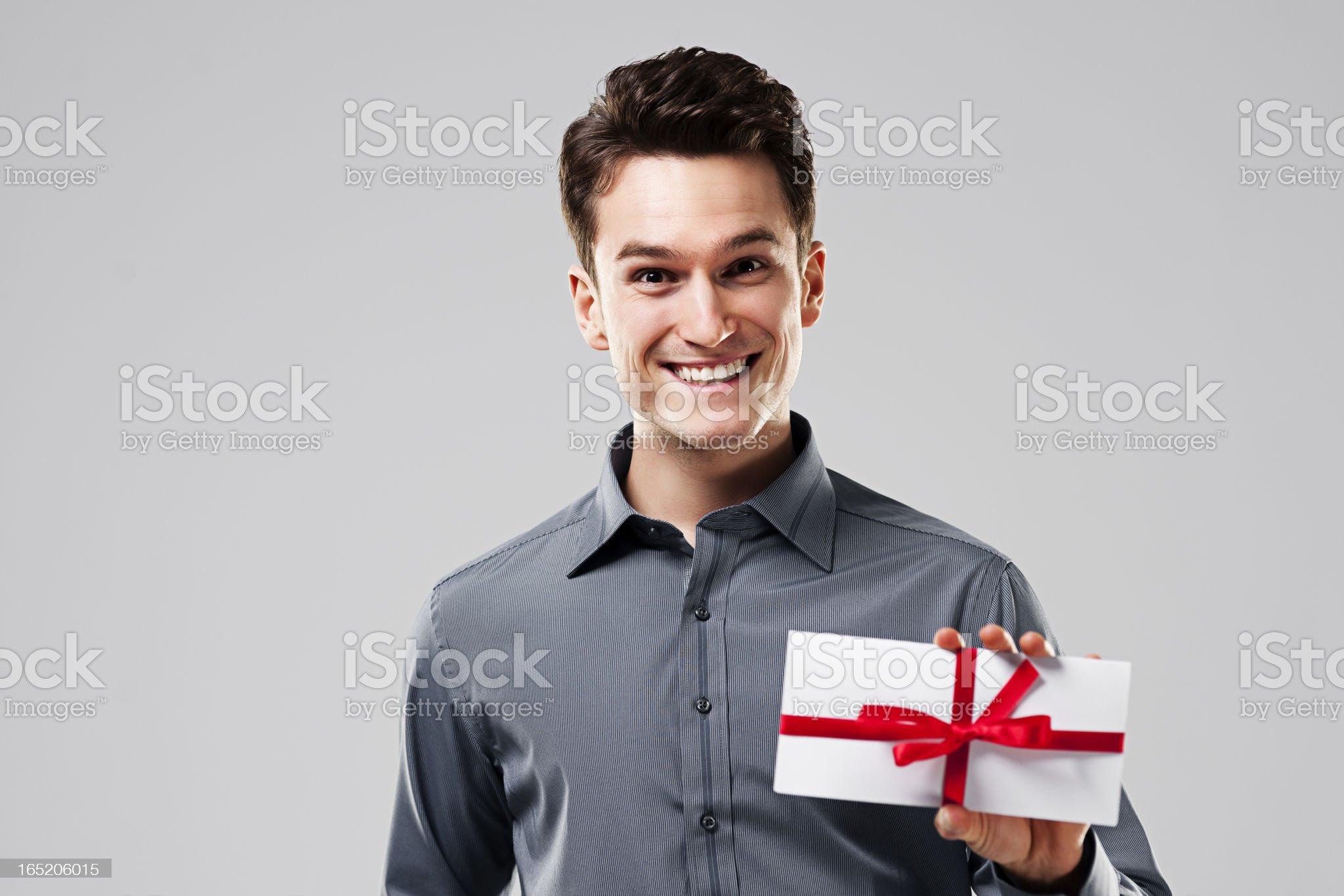 Happy man holding white card royalty-free stock photo