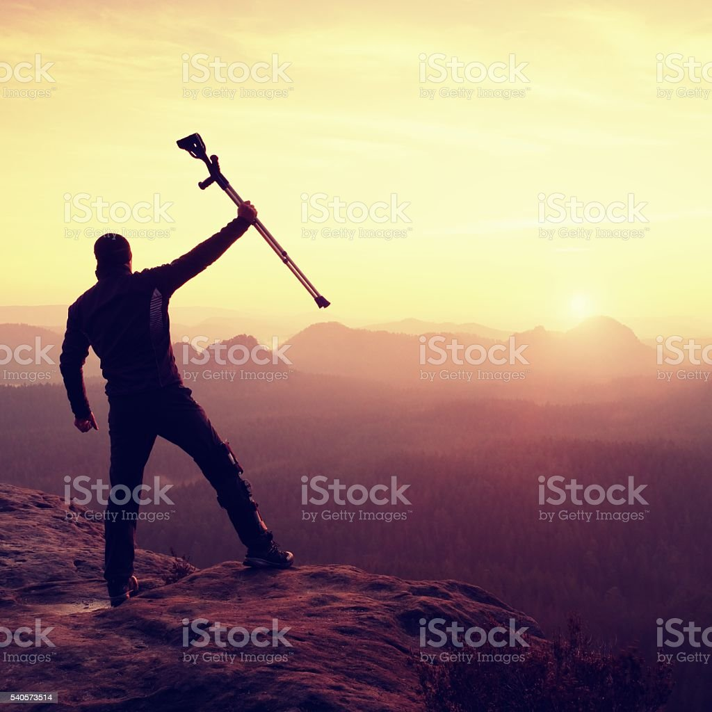 Happy man ill man celebrate achievement. Tourist  with broken leg stock photo