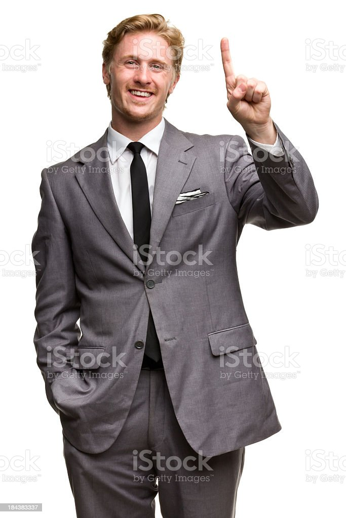 Happy Man In Suit One Finger Number 1 Hand Gesture royalty-free stock photo