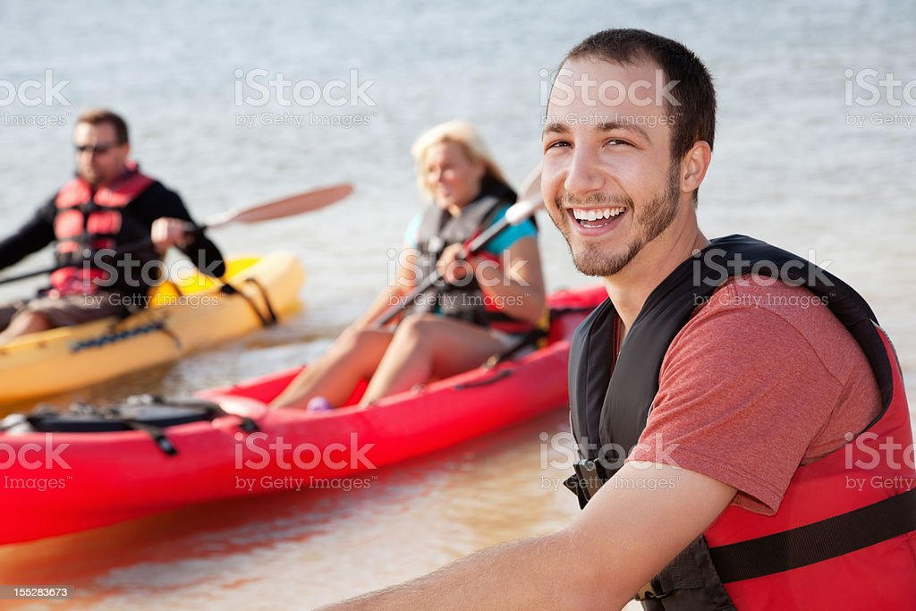 Happy man kayaking with his friends royalty-free stock photo