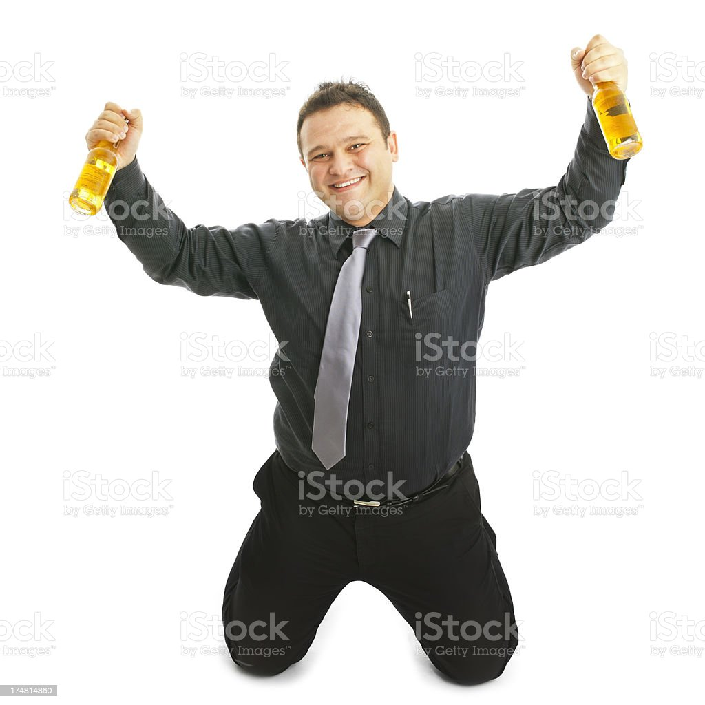Happy man Kneeling and holding beer bottle royalty-free stock photo