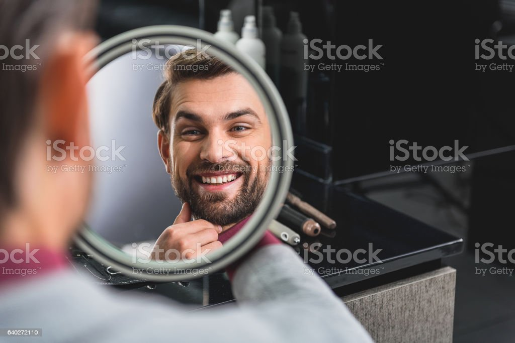 Happy man likes his hairstyle stock photo