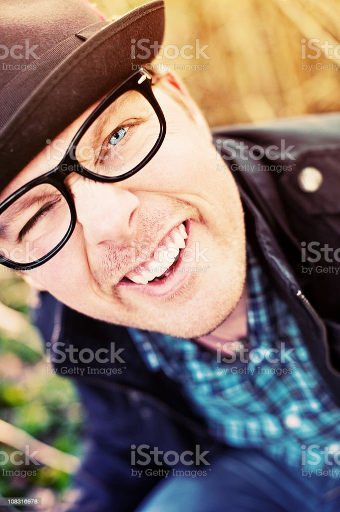Happy man looking at camera stock photo
