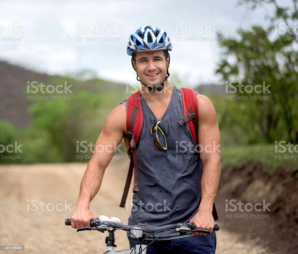 Happy man mountain biking stock photo