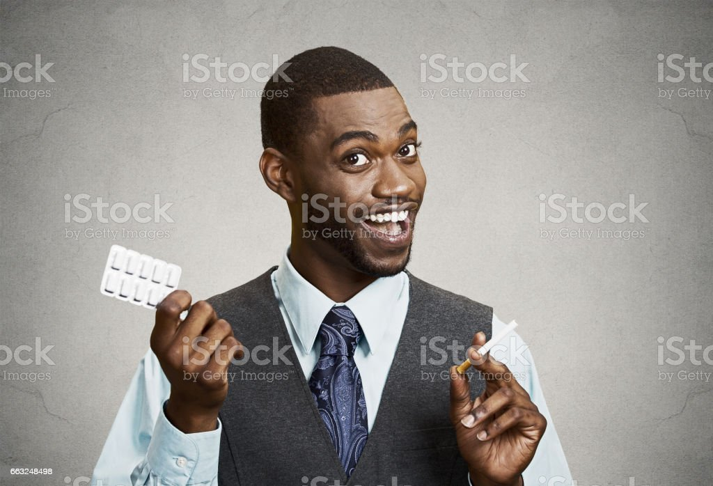 happy man offering Help with Cigarette Addiction, nicotine chewing gum stock photo