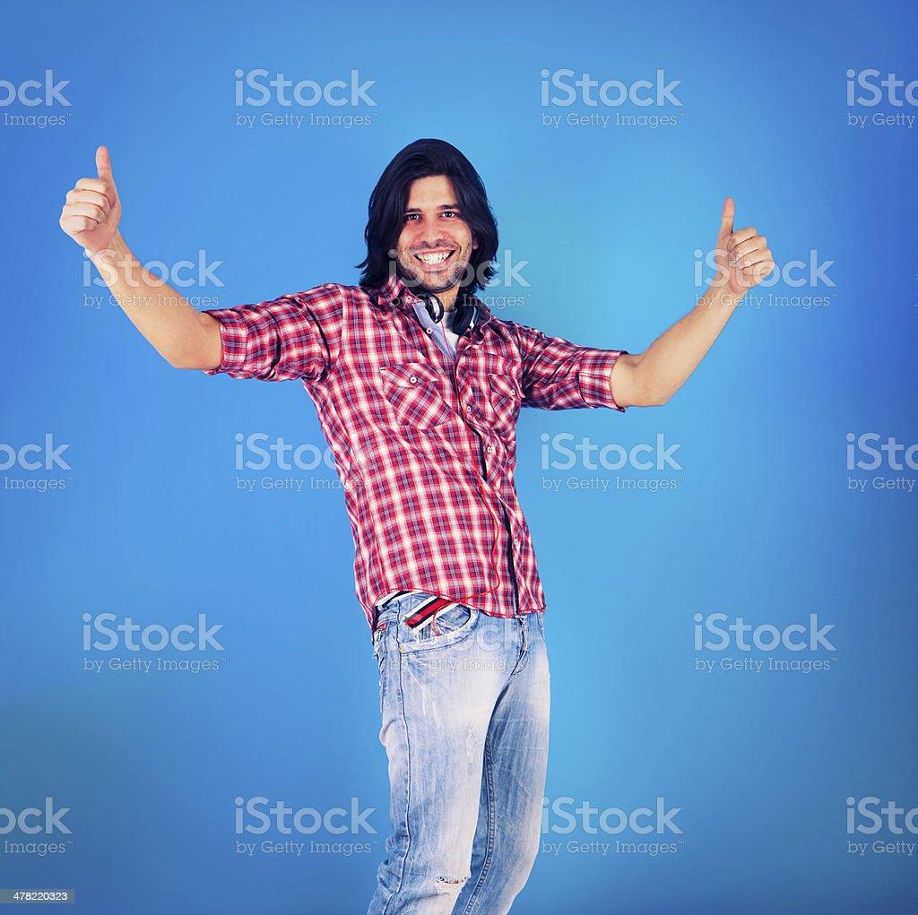 Happy man on blue background. royalty-free stock photo